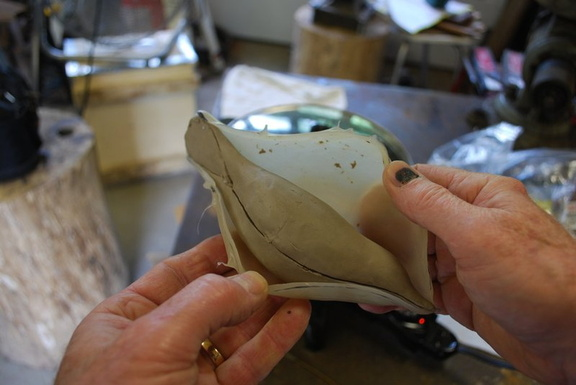 4. Having used a sharp knife to cut the Dip Seal where I want the seam to be, I now remove the rubbery Dip Seal skin.