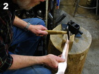 2. Starting the cylindrical form with hammer and wood V-block.
