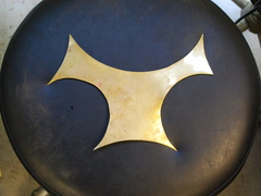 1. Scrap of 16 gauge brass, this one is almost symmetrical. I immediately thought of an animal.