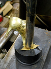 10. Using the hydraulic press on the ears.