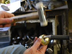 54. The piece of brass cut out, it's now being shaped on a ball stake.