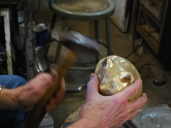 12. More hammering, on the front of the ears, using the same tool trhat was used with the press.