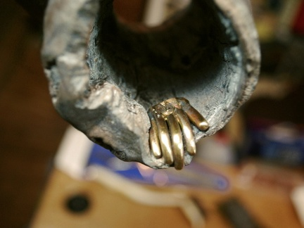 31. The hand secured with a screw.