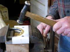 18. Forcing the form with hammer and a special jig.