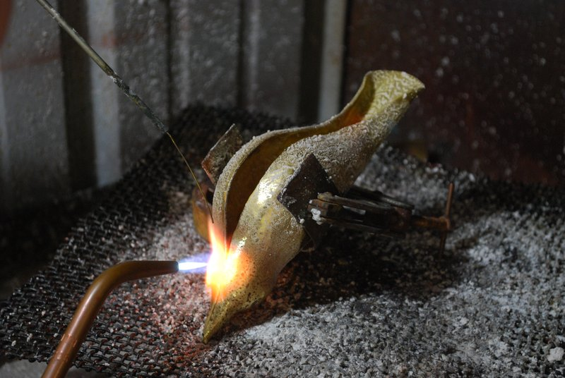 22. Silver-soldering the part of the seam that is closed up., then annealing the rest of it.