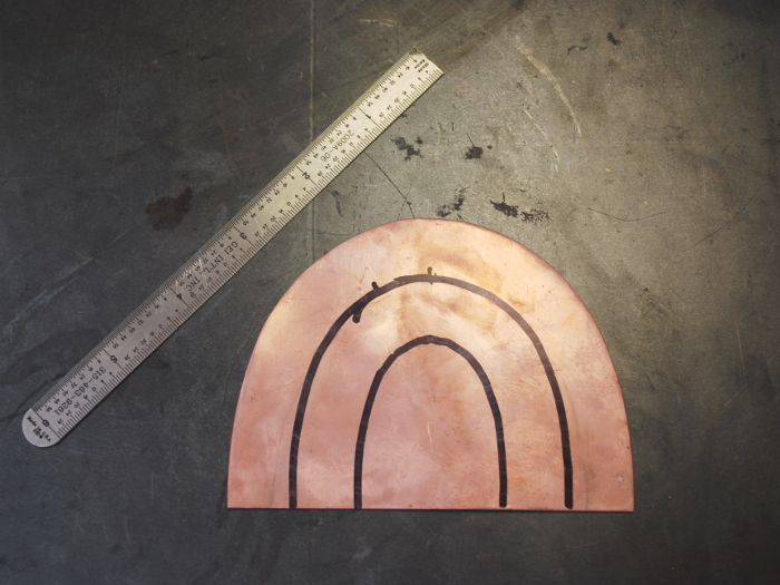 1. Starting with a more-or-less semicircular piece of 16 gauge copper sheet.