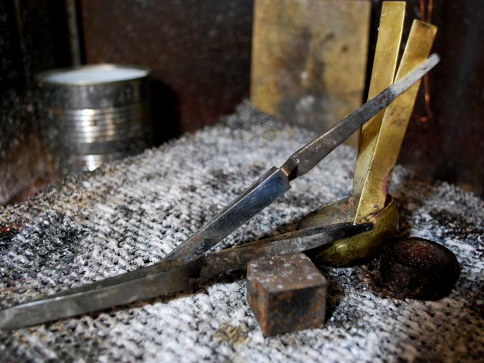 28. Straps of brass have been silver-soldered to the head, so it can be fastened invisibly to the interior of the wood.